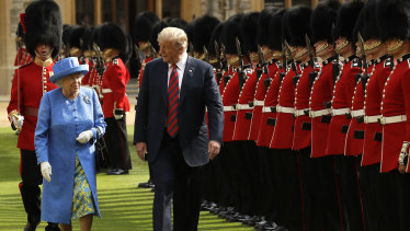 Donald Trump and the Queen inspect a Guard of Honour, formed of the Coldstream Guards at Windsor Castle.