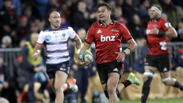 Running riot: David Havili streaks away to score another Crusaders try.