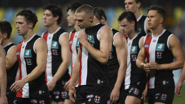 The Saints walk from the field after giving up a commanding lead against Adelaide.