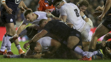 England's Ellis Genge goes over for the crucial try.