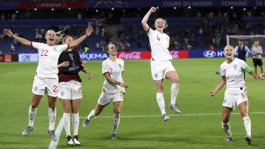 England celebrate their quarter-final triumph over Norway.