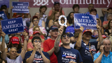 A supporter of US President Donald Trump holds up a sign referencing QAnon, a fringe movement that discusses several loosely connected and vaguely defined conspiracy theories, during a rally in Pennsylvania.
