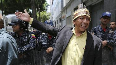 """Undemocratic"": Opposition MP Romel Edgardo Guzamana asks members of the Venezuelan Bolivarian National Police ""Why do you not let us pass?""."