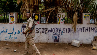 A soldier at the site outside Sudan's military headquarters in Khartoum, where pro-democracy protesters were dispersed in a lethal attack by paramilitary forces on June 11.