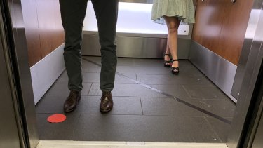 Social distancing markers in a Brisbane CBD lift.