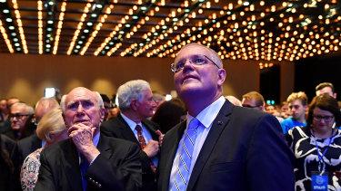 Prime Minister Scott Morrison and former prime minister John Howard await the result of the NSW election in Sydney.