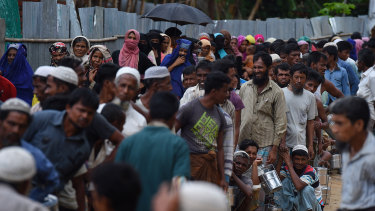 Rohingya refugees queue for a meal provided by a Turkish aid agency in the Shofiullah Kata camp, Cox's Bazar, Bangladesh.