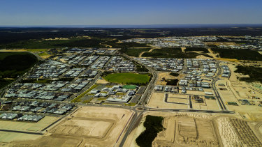 This drone shot shows Alkimos and its surrounds looking inland - the coastal strip where the north's growth will go. Wanneroo Road can just be seen in the top third, while state forest, national park and agricultural land can be seen beyond, illustrating the confines this expansion must be done within.