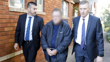 Police arrest a man in Sydney in relation to the alleged murder of Scott Johnon.