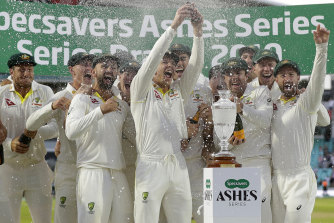 The Australian team, including Peter Siddle, celebrate with a replica of the Ashes at the Oval in September.