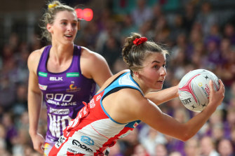 Maddy Proud of the NSW Swifts in action during a Super Netball match against the Firebirds in Brisbane last year.