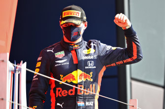 Red Bull Racing's Max Verstappen celebrates on the podium after winning the 70th Anniversary Grand Prix at Silverstone on Sunday.