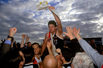 Danny Frawley is chaired off the ground after his last match in 1995.