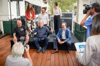 All together now: Missy Higgins, Paul Dempsey and Gordi with (front row) Howard Freeman (founder of road crew organisation Crew Care), Michael Gudinski and Martin Pakula.