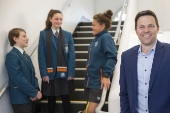 Preston High principal Sean Butler with year 7 students Marcus, Lili and Jasmine.