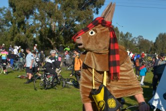 A cyclist dressed as a horse in the 2013 Melburn Roobaix.