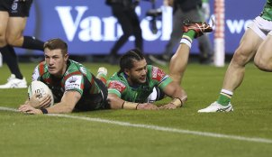 Campbell Graham scores for the Rabbitohs in the first half in Canberra.