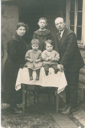 Phillip (sitting front left) with his family at his grandma's house in the early 1920s.