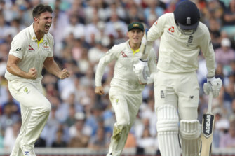 Mitchell Marsh celebrates taking the wicket of Sam Curran.