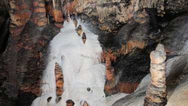 Flowstone resembling ice cream or snow in the Jersey Cave, one of several snow caves at Yarrangobilly Caves.