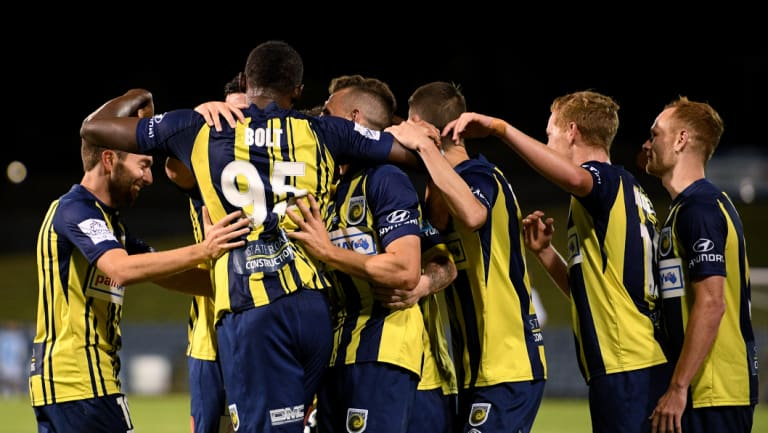 Off the mark: Usain Bolt is mobbed by his Mariners teammates after opening his account.