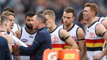 Selection misfires: Don Pyke talks with his players during the match against Carlton at the MCG on Saturday.