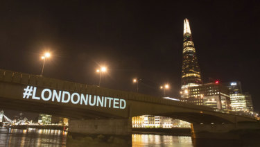 A tribute is projected onto the side of London Bridge to mark one year since the attack.