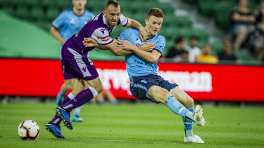 On the move?: Brandon O'Neill, right, wrestles with Perth Glory defender Ivan Franjic.