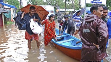 Flood victims are evacuated.