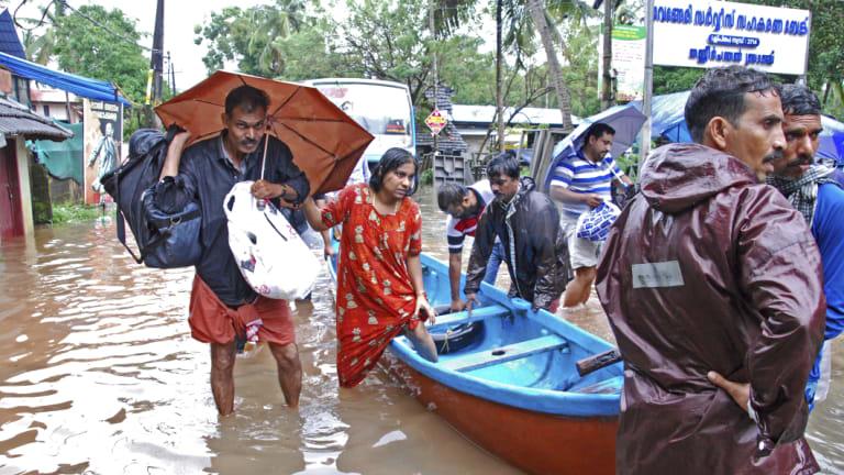 Flood victims are evacuated.
