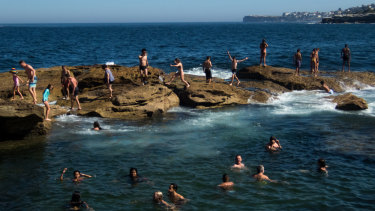 Swimmers cool off in Giles Baths in Coogee.