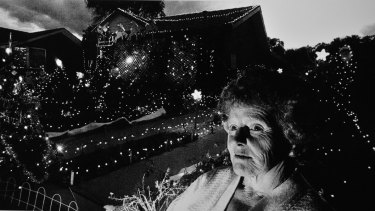 Bev Lucas outside her then home in Walker Crescent, Narrabundah, with her Christmas lights in 1983.