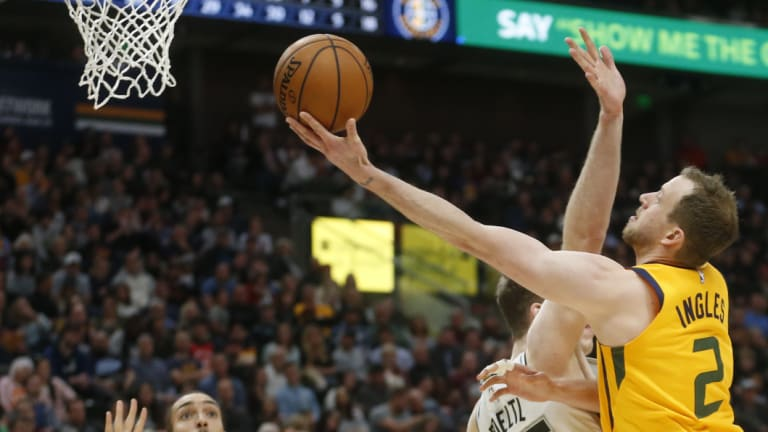 Prime time: Joe Ingles lays the ball up for Utah Jazz as San Antonio Spurs center Jakob Poeltl defends.