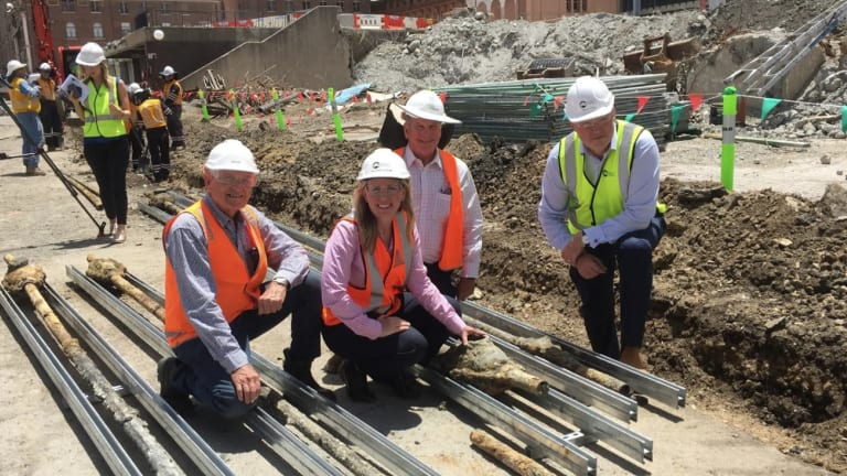 Tourism Industry minister Kate Jones with Destination Brisbane project director Simon Crooks (right) at the unearthing of the 134-year-old electrical cables.