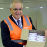 Prime Minister Scott Morrison holds a box of AstraZeneca vaccines at the CSL factory in Melbourne last month.