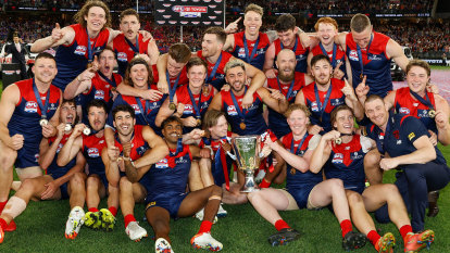 As it happened: Rampaging Demons clinch 13th premiership, Petracca best on ground, Norm Smith curse broken