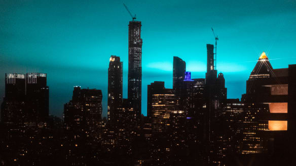 Night sky turns blue in New York as power station fire erupts