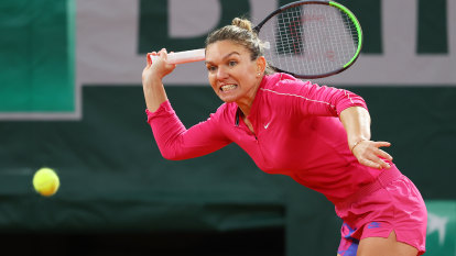 Halep crashes out of French Open as Nadal salvages pride for the old guard