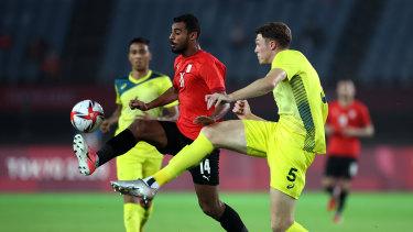 Australia's beanpole defender Harry Souttar tries to intercept Egypt's Ahmed Rayan.