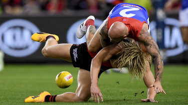 Nathan Jones tackles Dyson Heppell.