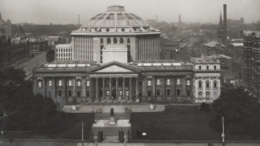 View of the Melbourne Public Library, including the domed reading room, from across Swanston Street. c.1915.