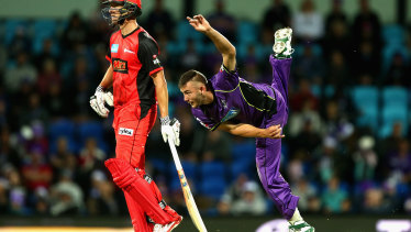 Aaron Summers, right, bowling for the Hobart Hurricanes in 2017.
