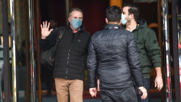 Returned traveller Patrick Enright (left) finishes his two-week hotel quarantine on Tuesday.