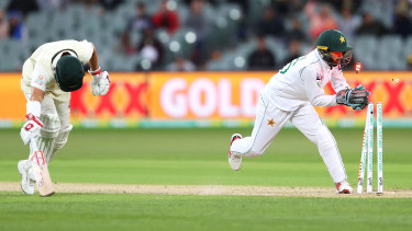 David Warner stretches out to make his ground after dashing through for another run in his triple century.
