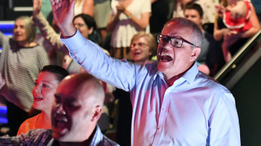 Scott Morrison sings during an Easter Sunday service at his Pentecostal church, Horizon, in Sydney.
