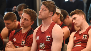 Jack Billings, Sam Rowe and Blake Acres watch and listen as coach Alan Richardson steps down.