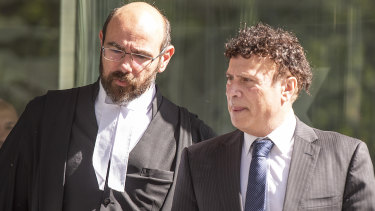 Nino Napoli (right) leaves a directions hearing at the County Court on Friday.