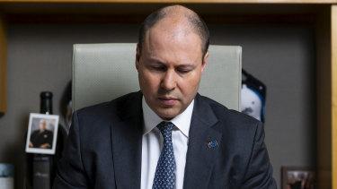 Treasurer Josh Frydenberg says Victoria's economic struggles will knock $14 billion off the national economy.