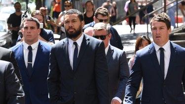 Adam Elliott, Asipeli Fine and Josh Jackson leave the Downing Centre Court in December last year.