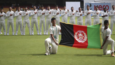 Afghanistan's players line up for the national anthem in their first ever Test in 2018.